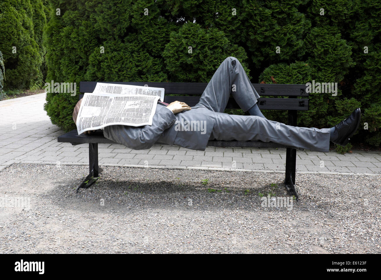 Between Appointments - Businessman sleeping under Newspaper - Sculpture by Seward Johnson - NJ Grounds for Sculpture - Stock Image