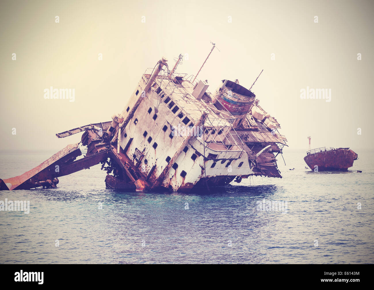The sunken shipwreck on the reef, Egypt, vintage retro filtered. - Stock Image