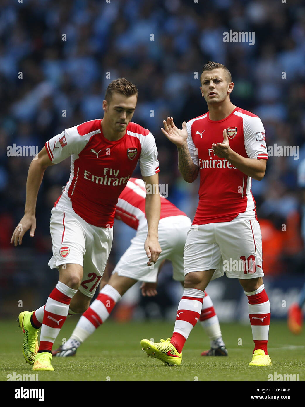 London, UK. 10th Aug, 2014. Jack Wilshere (R)of Arsenal looks on ahead of the Community Shield match between Arsenal - Stock Image