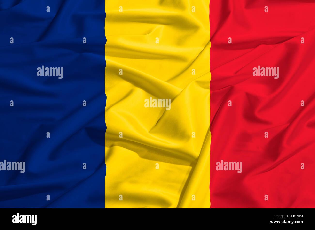 Romania flag on a silk drape waving - Stock Image