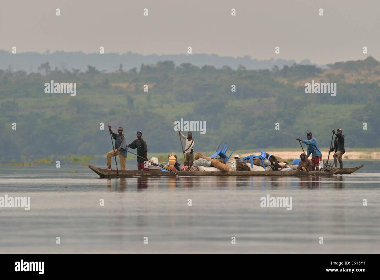 Fishermen on a pirogue on the Congo River, near Tshumbiri, Bandundu Province, Democratic Republic of the Congo - Stock Image