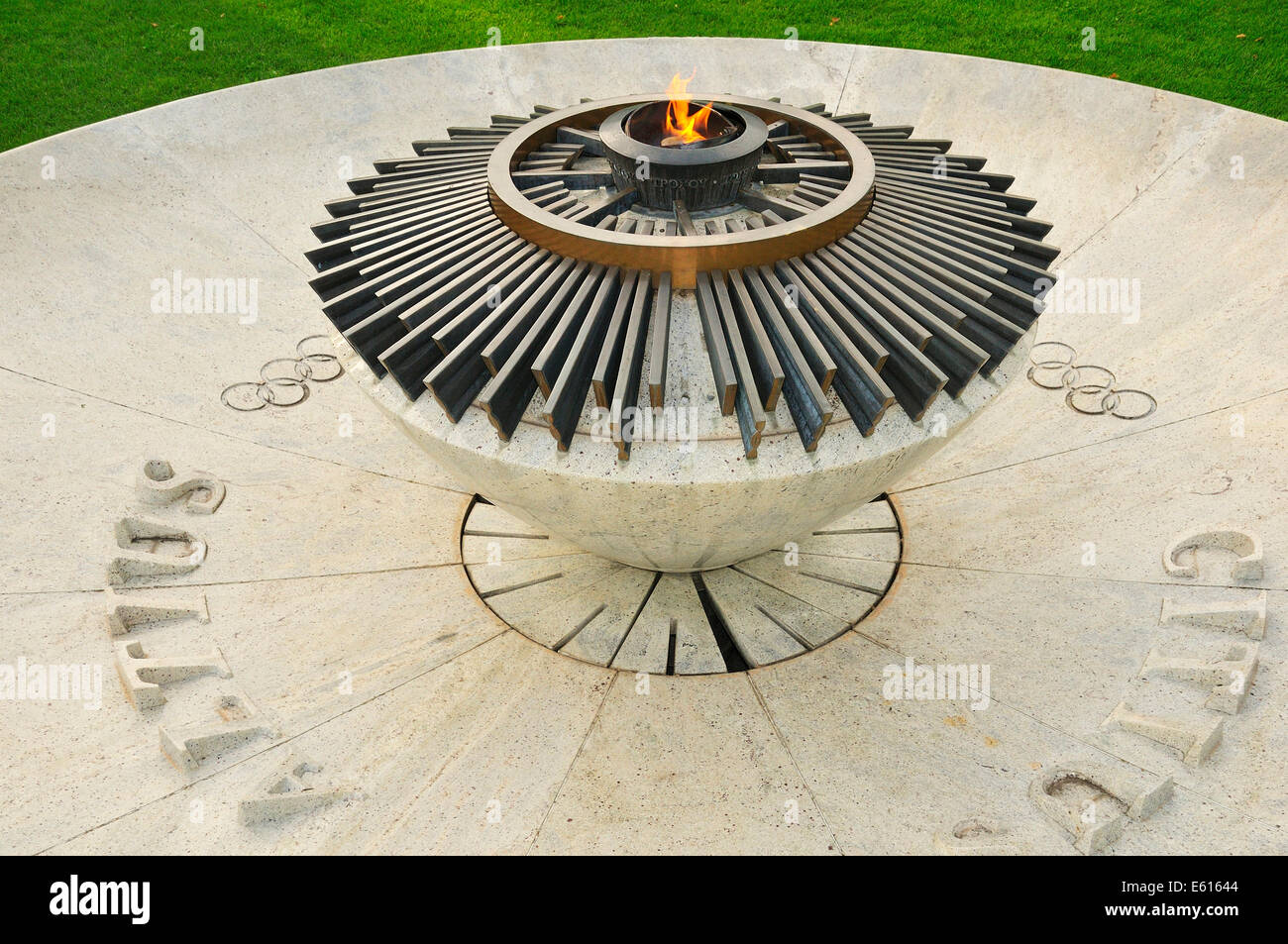 Constantly burning Olympic flame at the Museum Park, Olympic Museum, Lausanne, Canton of Vaud, Switzerland - Stock Image