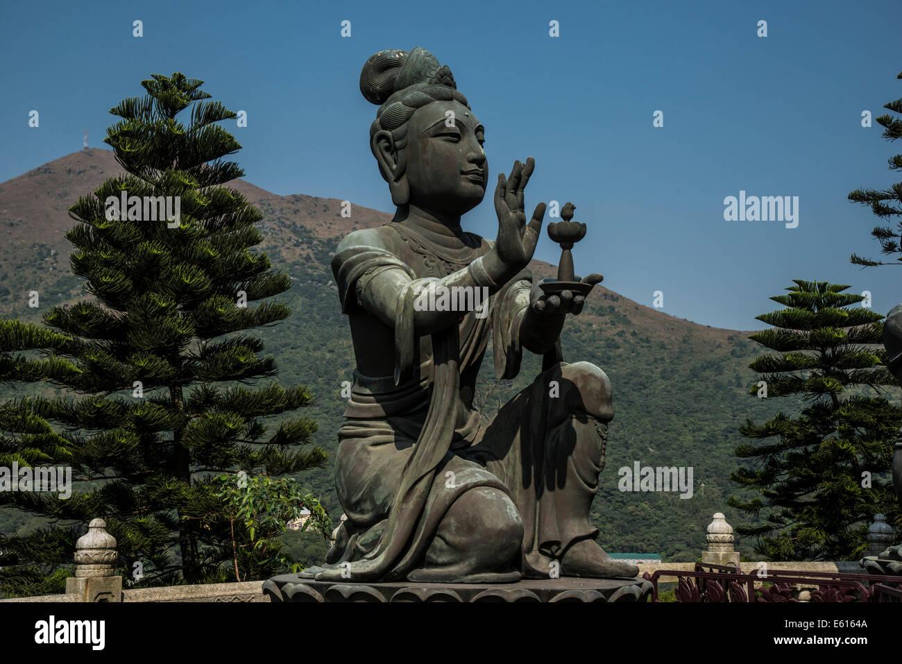 Buddhist statue praising Tian Tan Buddha or the Big Buddha, Lantau Island, Hong Kong, China - Stock Image