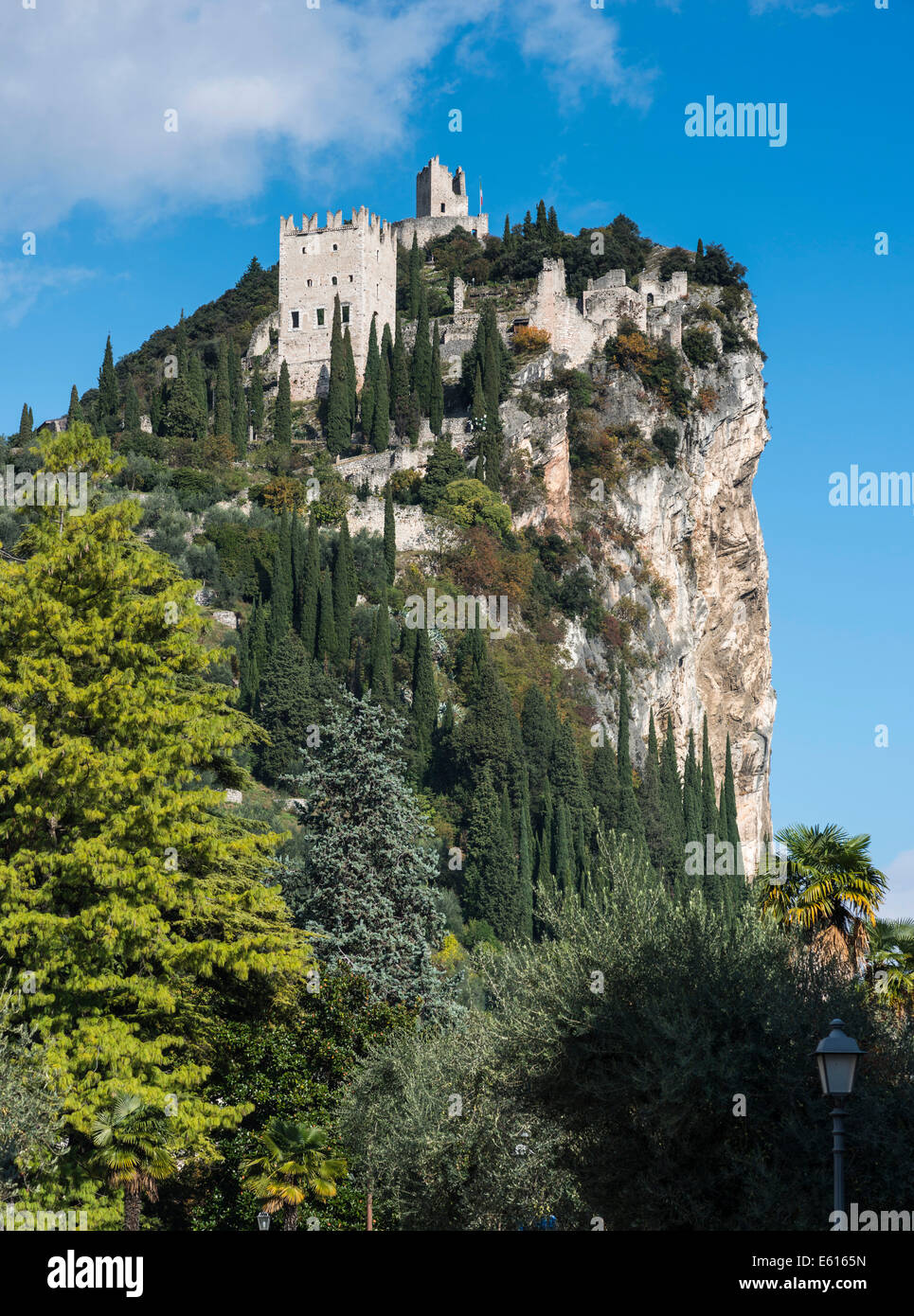 Mighty cliff with the ruins of Arco Castle or Castello di Arco above Arco, Sarca Valley, Trentino-Alto Adige, Italy Stock Photo