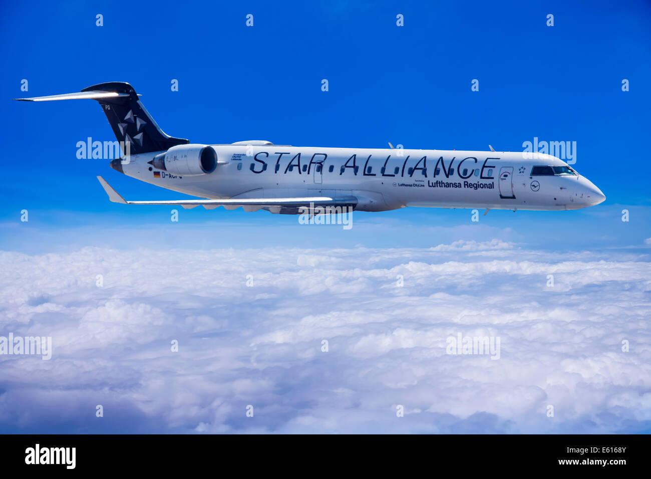 Star Alliance, Bombardier CRJ 700 aircraft, in flight - Stock Image