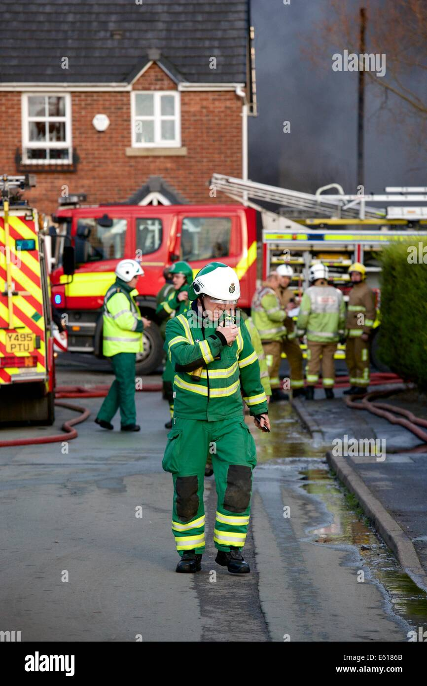 A North West Ambulance Service Hazardous Area Response Team (HART) operative attends a major fire in Crewe, Cheshire. - Stock Image