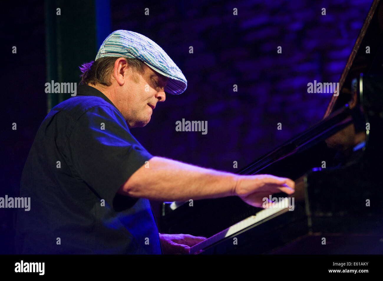 Pianist with Gregory Porter band performing on stage at Brecon Jazz Festival 2014 - Stock Image