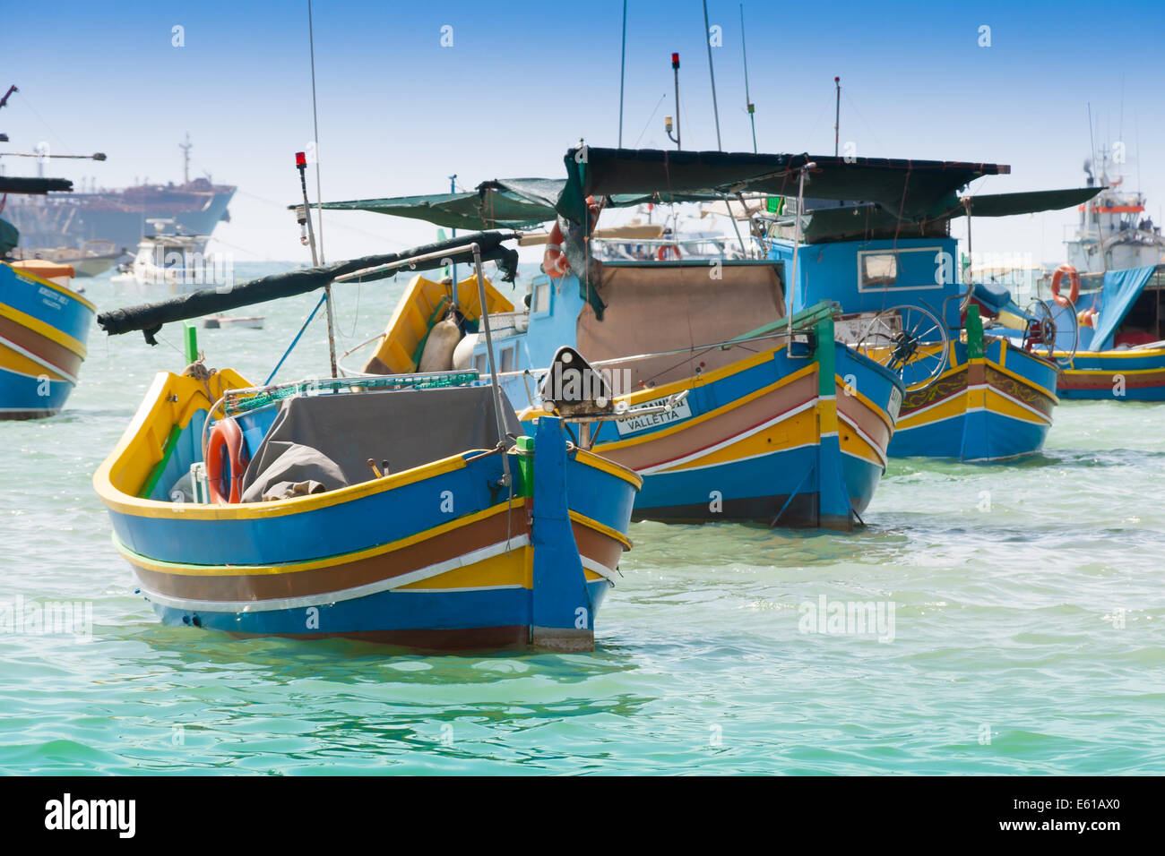 Traditional fishing boat (luzzu) in Marsaxlokk, a fishing village located in the south-eastern part of Malta. - Stock Image