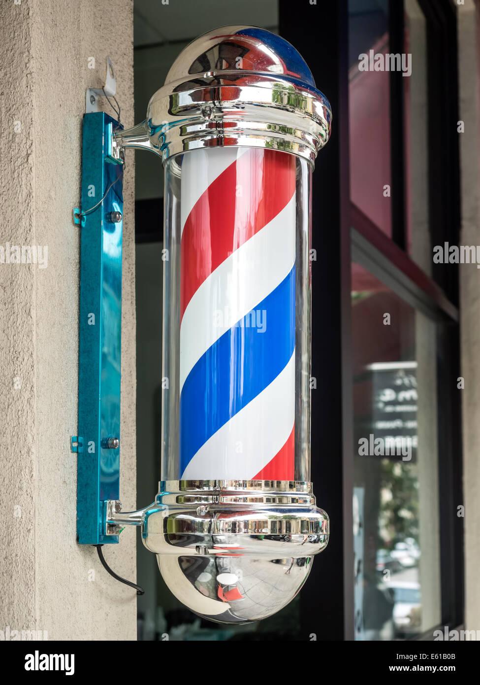 Vintage barber shop sign with rotating stripes - Stock Image