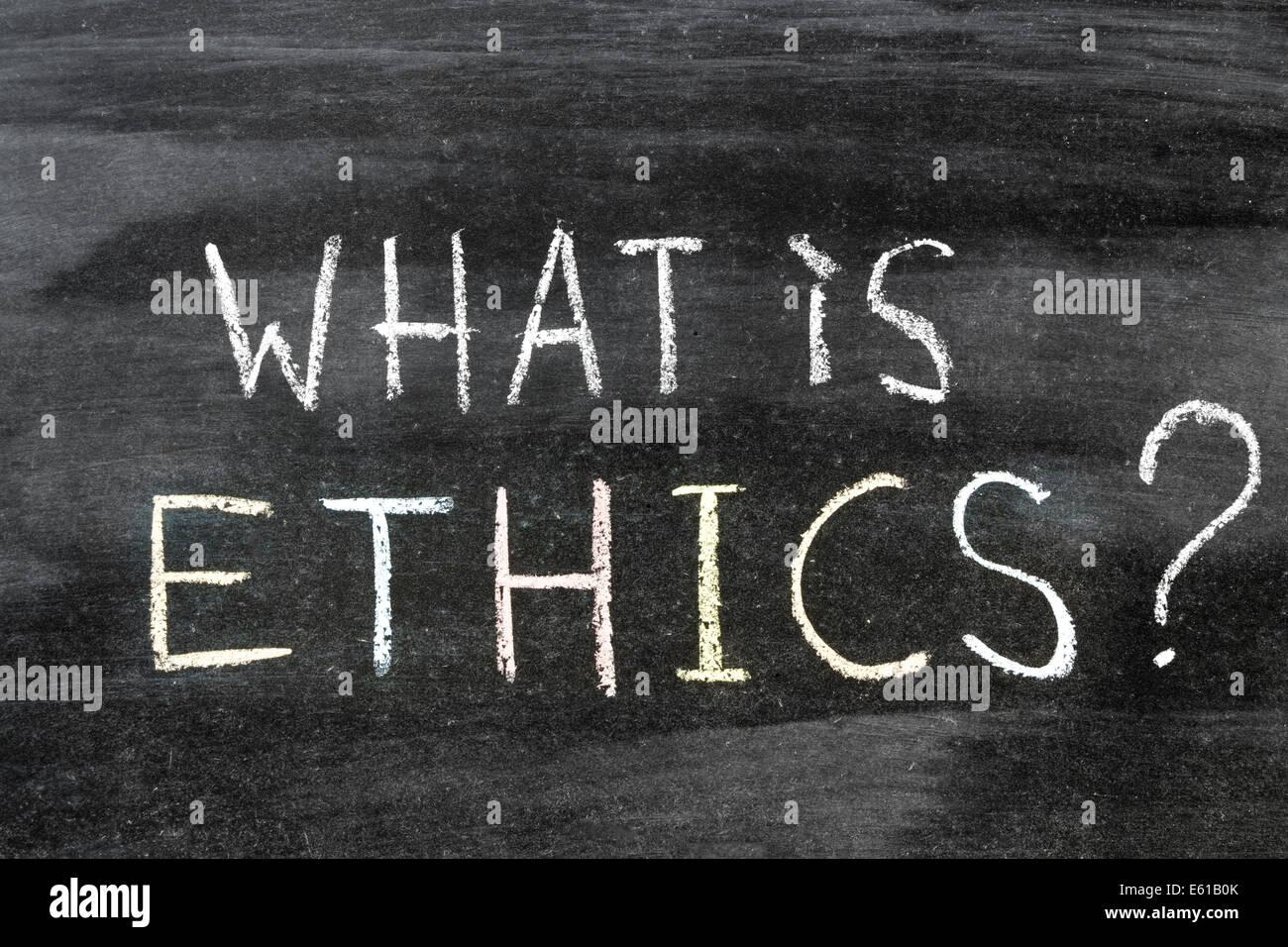 what is ethics question handwritten on the school blackboard - Stock Image