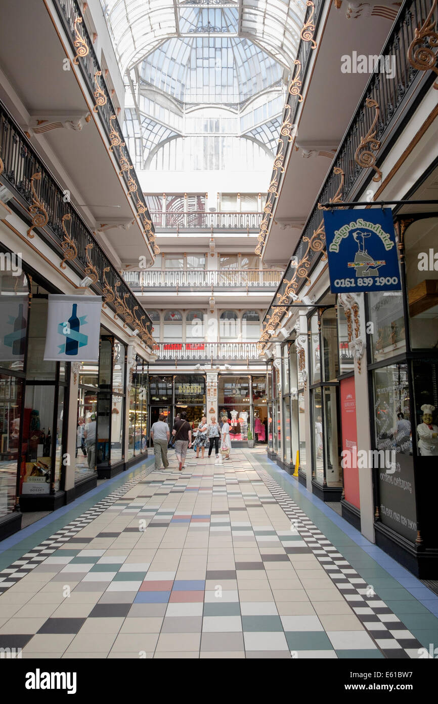 Victorian shopping arcade covered by a glass roof. Barton Arcade, Deansgate, Manchester, England, UK, Britain - Stock Image