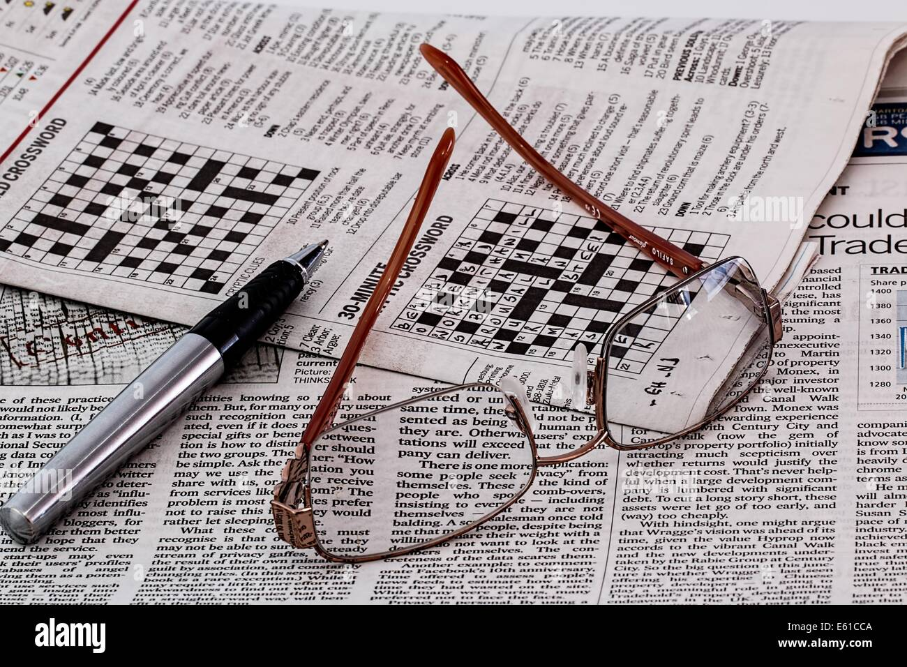 newspaper news media spectacles glasses paper - Stock Image