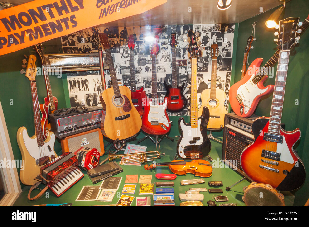 England, Merseyside, Liverpool, Albert Dock, The Beatles Story, Recreated Window of Hessys Music Centre that Closed - Stock Image