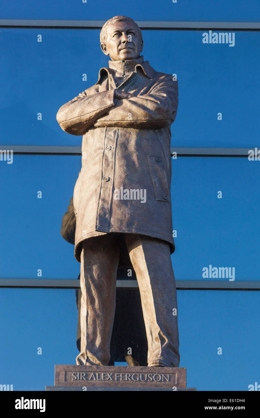 England, Manchester, Salford, Old Trafford Football Stadium and Statue of Alex Ferguson - Stock Image