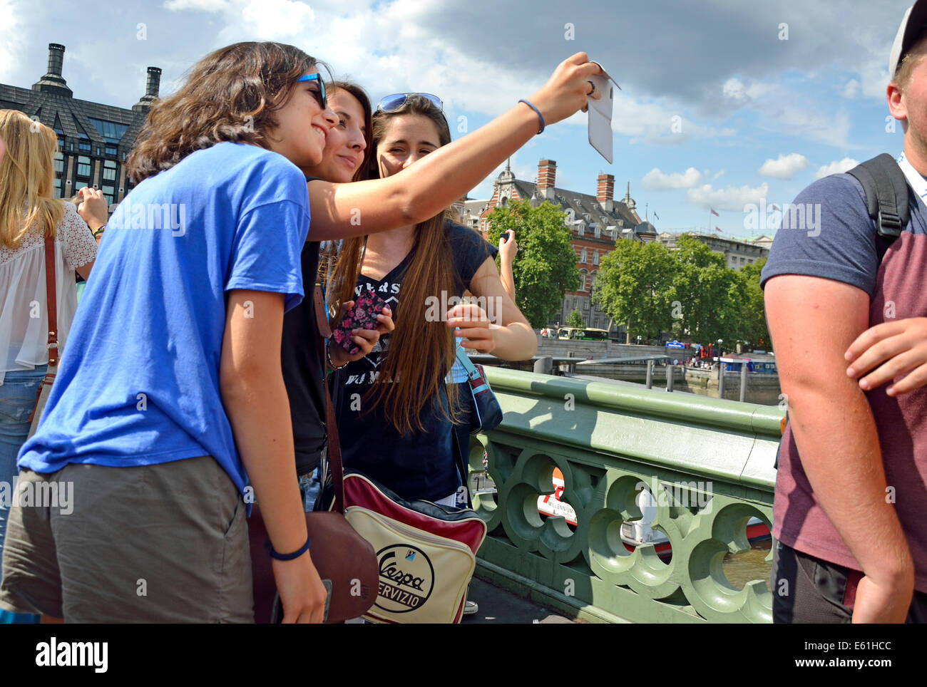 London, England, UK. Three young women on Westminster Bridge taking a selfie with a mobile phone - Stock Image