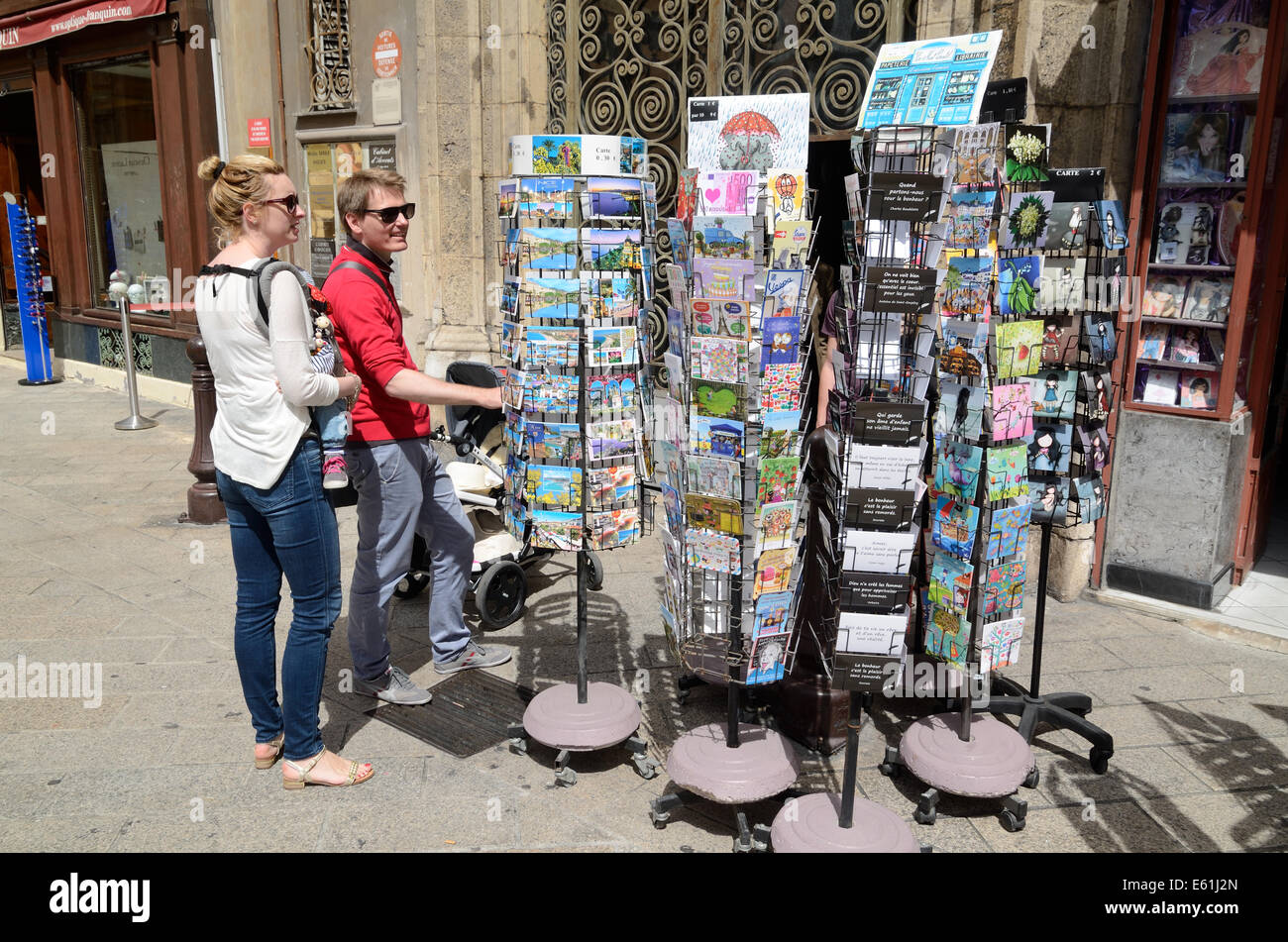 Tourists Choosing Postcards Outside a Souvenir Shop or Gift Shop in Nice Alpes-Maritimes France - Stock Image
