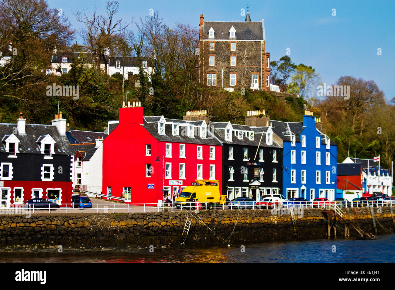 Coloured houses on the harbour at Tobermory, Isle of Mull. - Stock Image