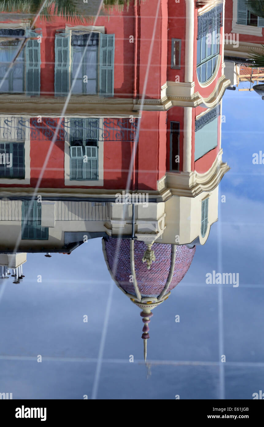 Reflections of Belle Epoch Architecture in Miroir d'Eau Fountain on Place Massena, Town square or Plaza Nice - Stock Image