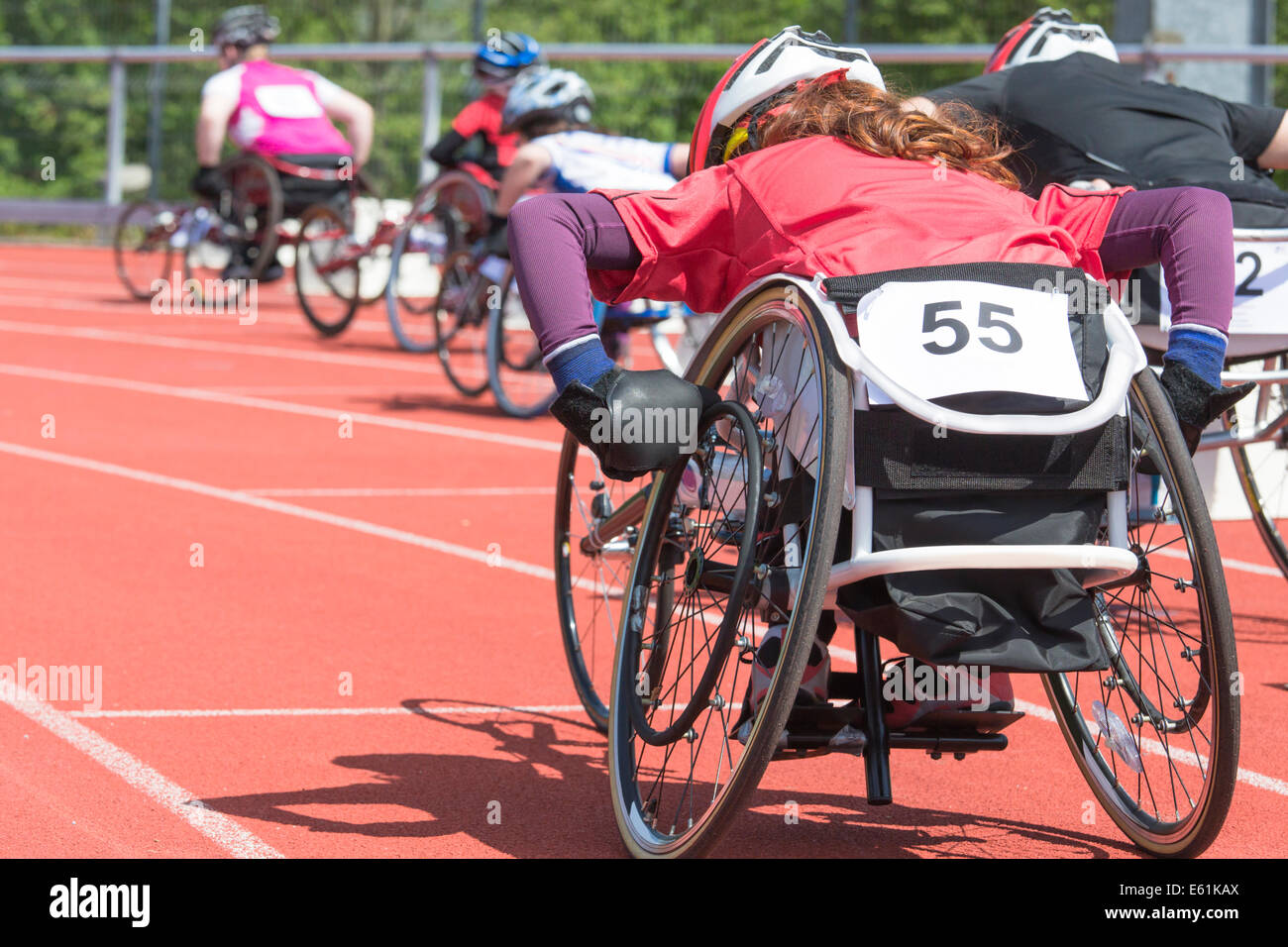 Athletes  at a wheelchair race in a stadium - Stock Image