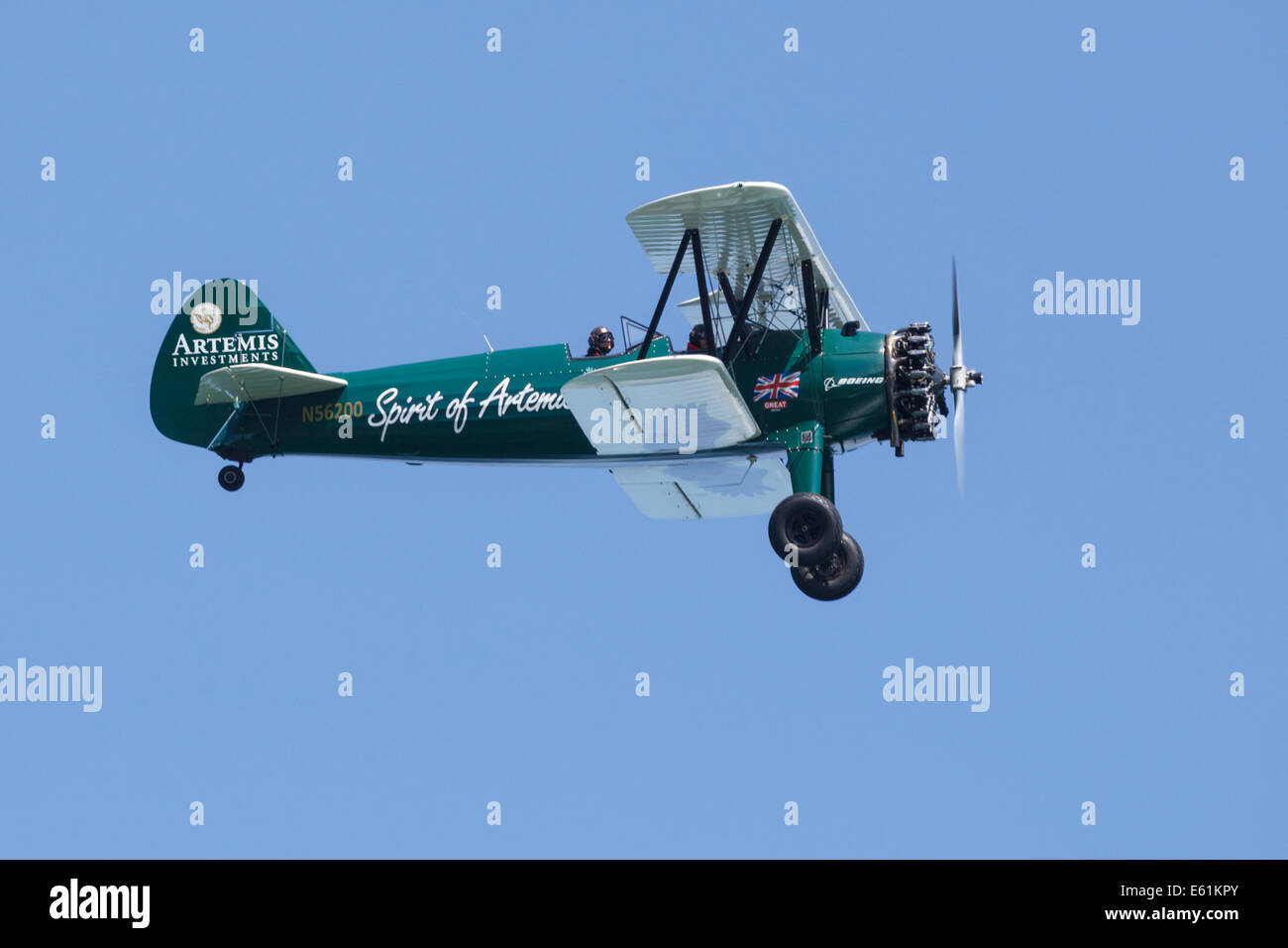 Spirit of Artemis Biplane with pilots flying over Cowes, Isle of Wight - Stock Image
