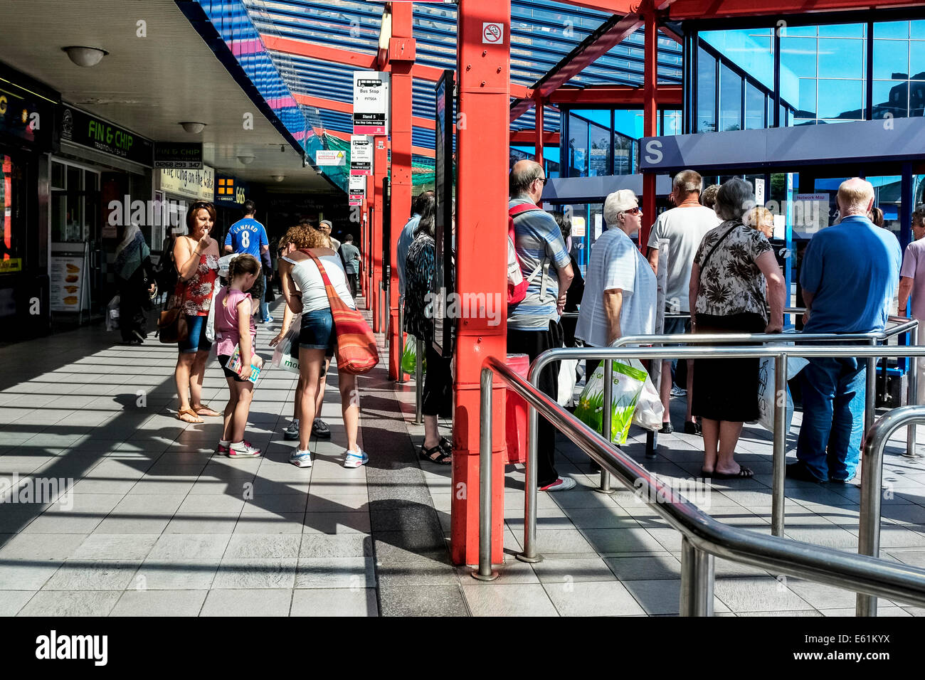 People queueing in Basildon Bus Station. Stock Photo
