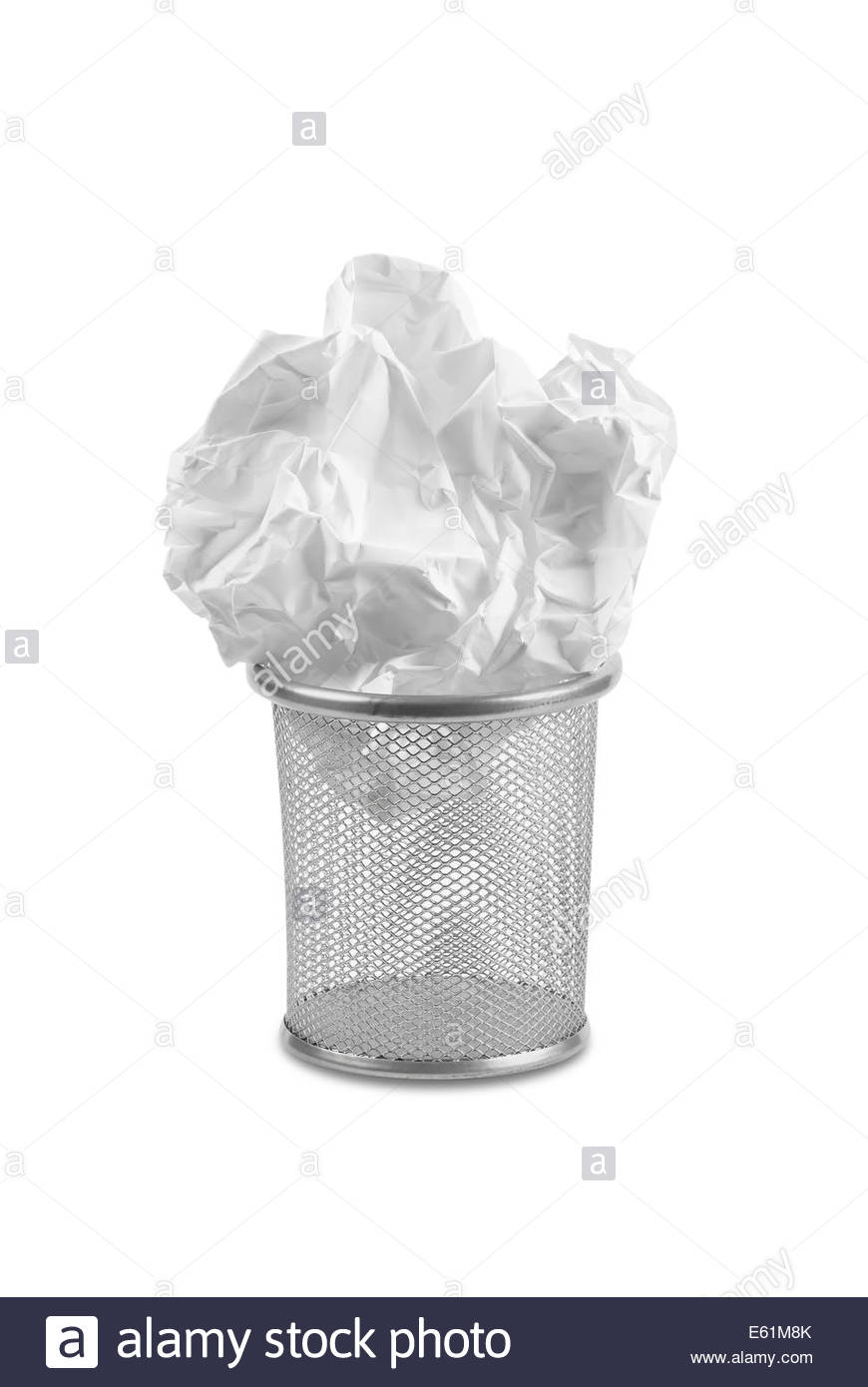 Wastepaper bin with large screwed up paper crammed on top. - Stock Image