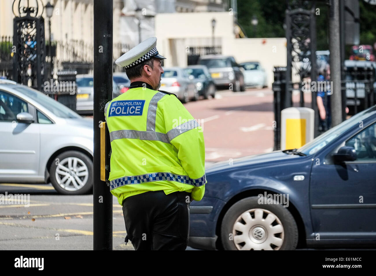 A Metropolitan police officer watching traffic at a junction. - Stock Image
