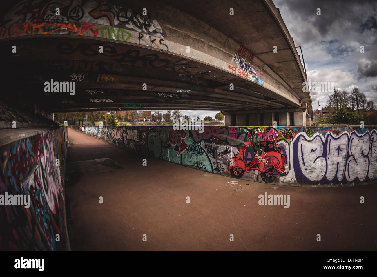 Graffiti street art under road bridge. - Stock Image