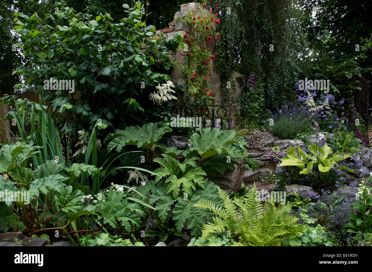 The Forgotten Folly Summer Garden at RHS Hampton Court Palace Flower Show 2014 - Stock Image