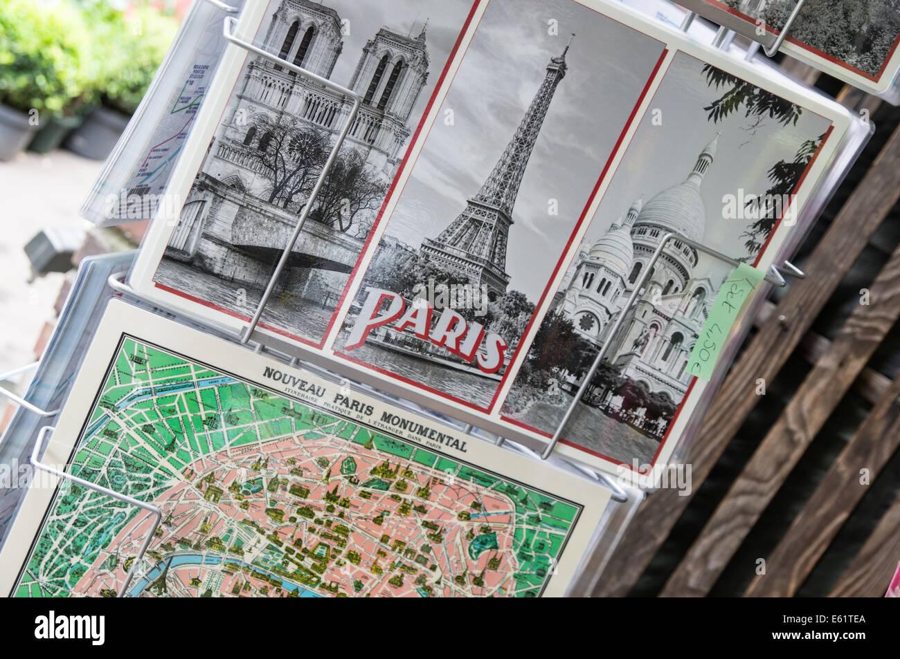 Postcards racks at flower market at Ile de la Cite in Paris, France - Stock Image