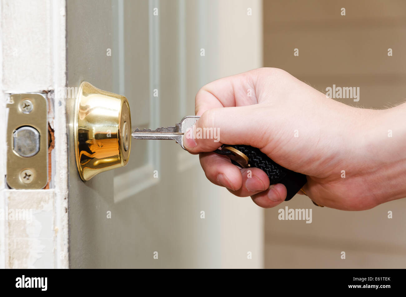 Photo Of Male Hand Putting House Key Into Front Door Lock Of House