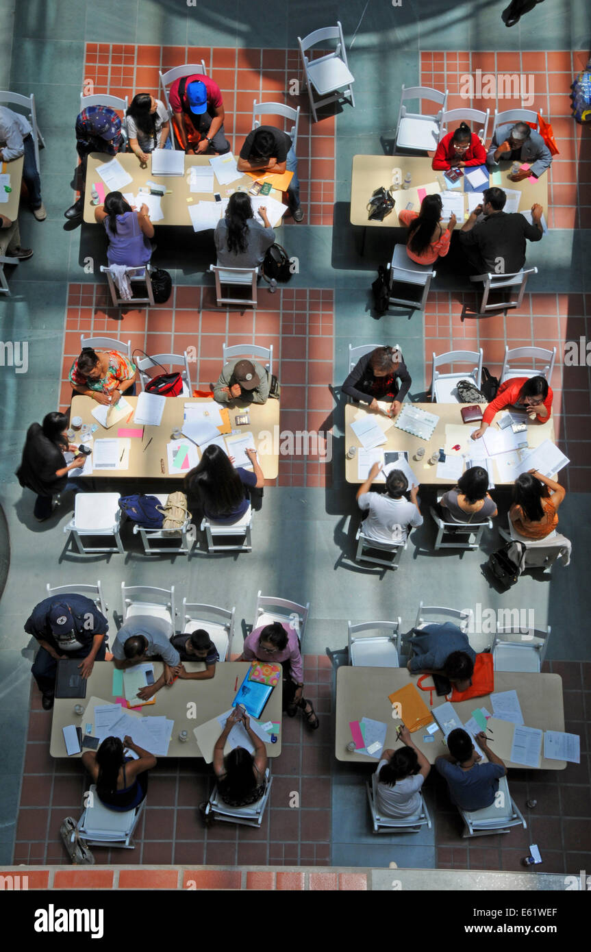 Students taking written test at Los Angeles Central Library - Stock Image