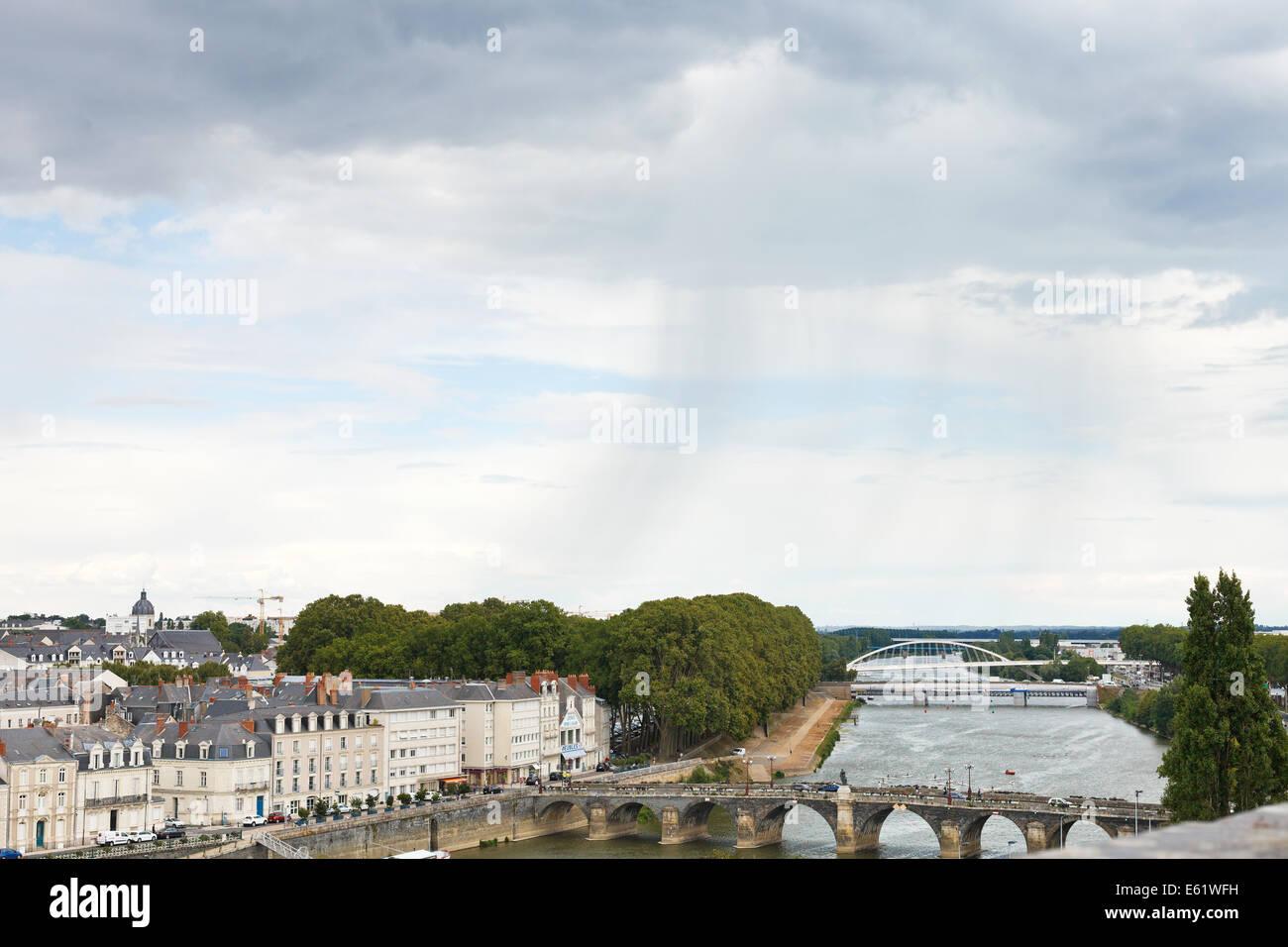 ANGERS, FRANCE - JULY 28, 2014: rain over bridges Pont de Verdun and Pont de Haute Chaine on La Maine river in Anges, - Stock Image