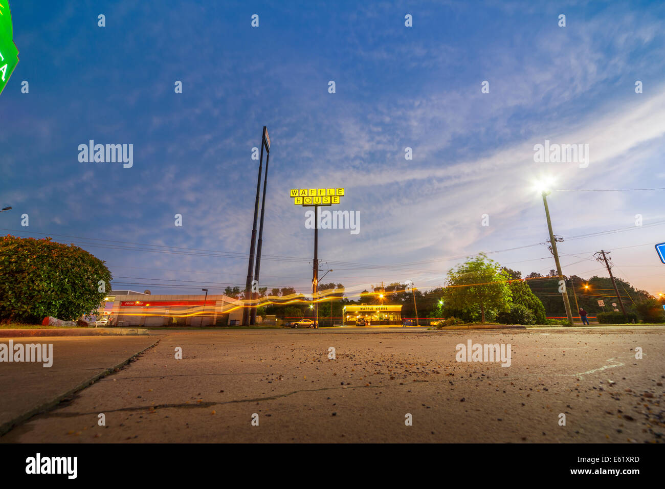 Waffle House Restaurant roadside diner at night evening dusk with light streaks Montgomery Alabama interstate highway - Stock Image