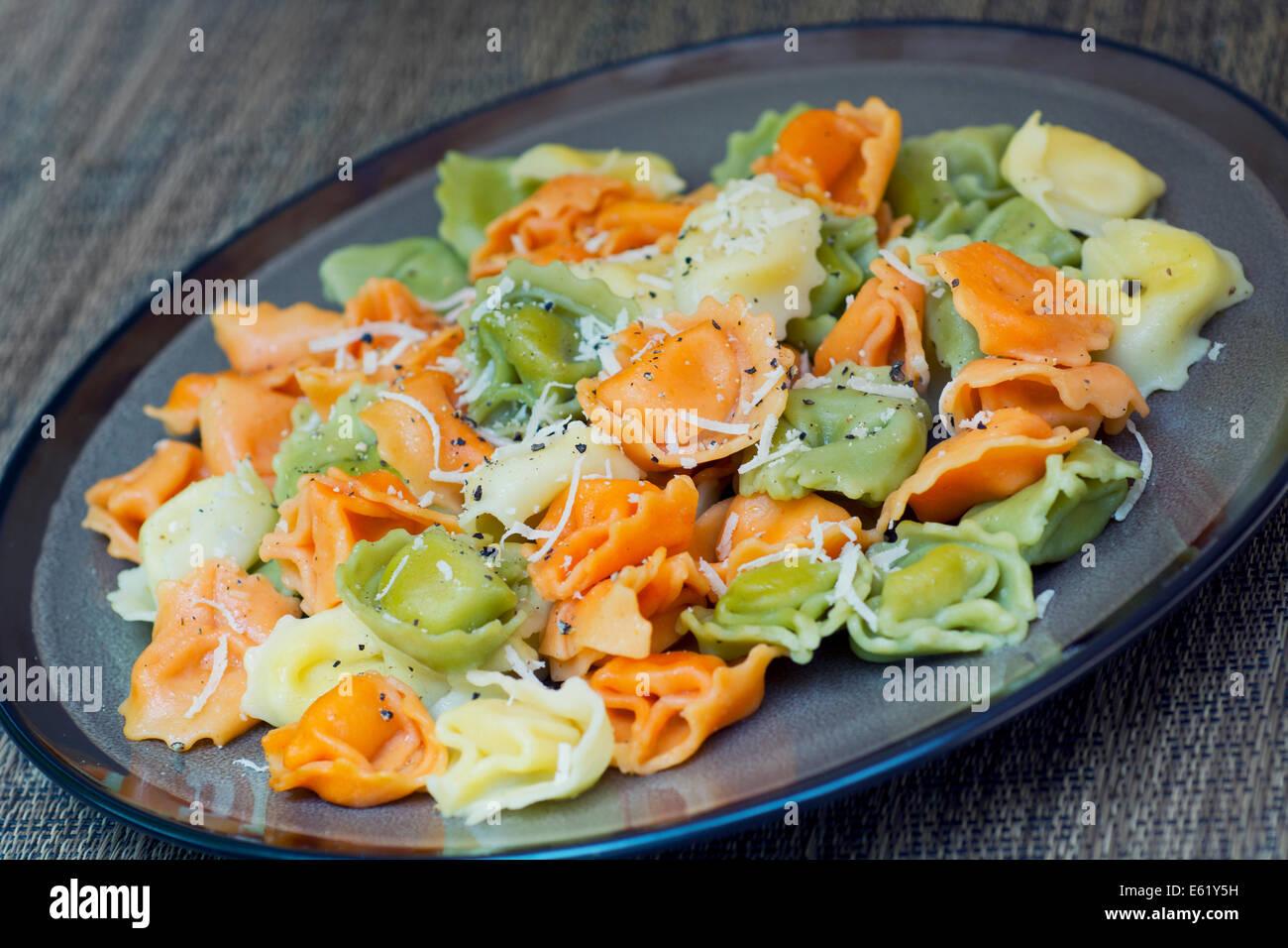 Plate of Tricolor Tortellini - Stock Image