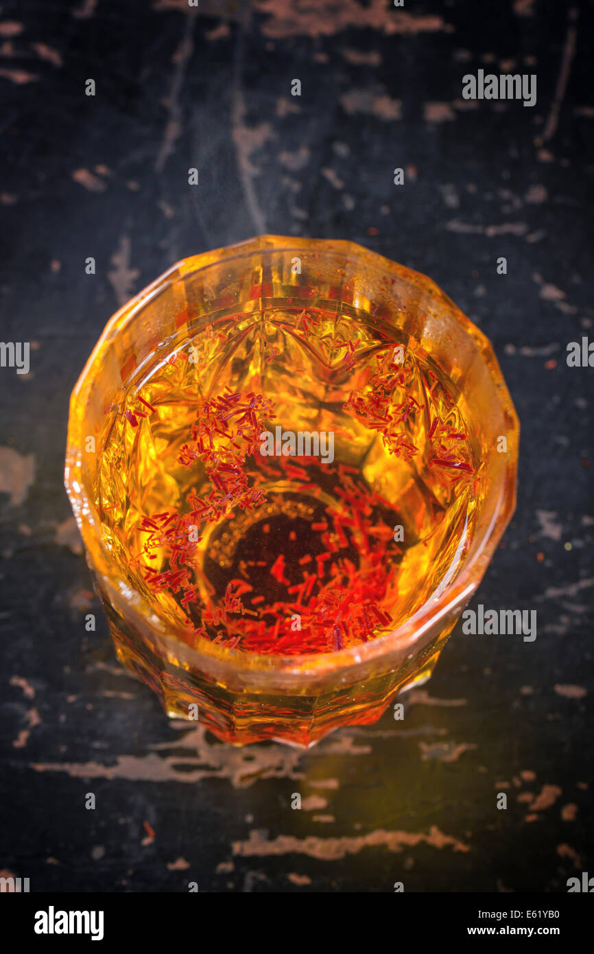 Vintage glass with saffron hot water. Top view. Stock Photo