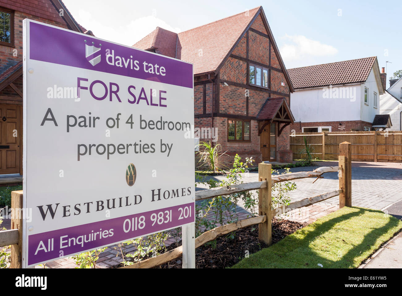 For Sale sign outside new build housing. - Stock Image