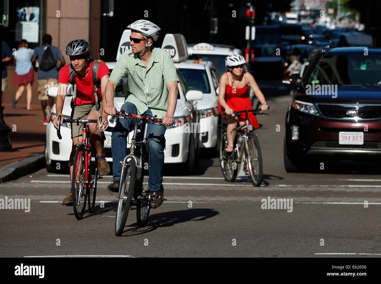 Bicyclists on State Street, downtown, Boston, Massachusetts, USA - Stock Image