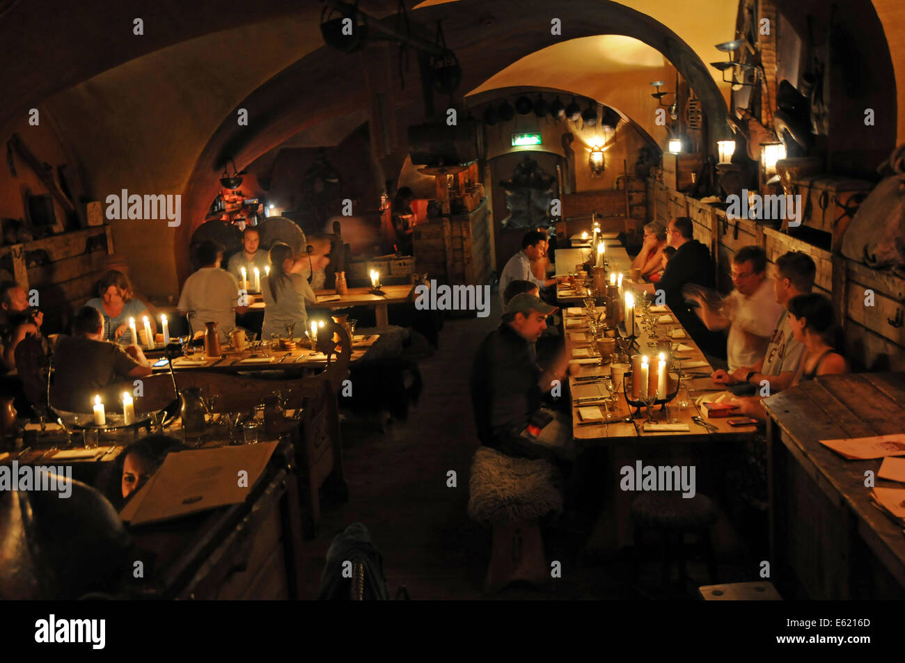 People at indoor restaurant built underground in a cave in the Old Town called Gamla Stan in Stockholm - Stock Image