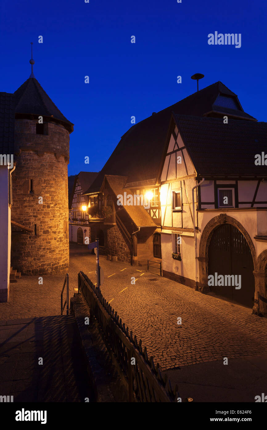 Historical Town Hall with a fortified wall and the tower of a fortified church, Dörrenbach, German Wine Route - Stock Image