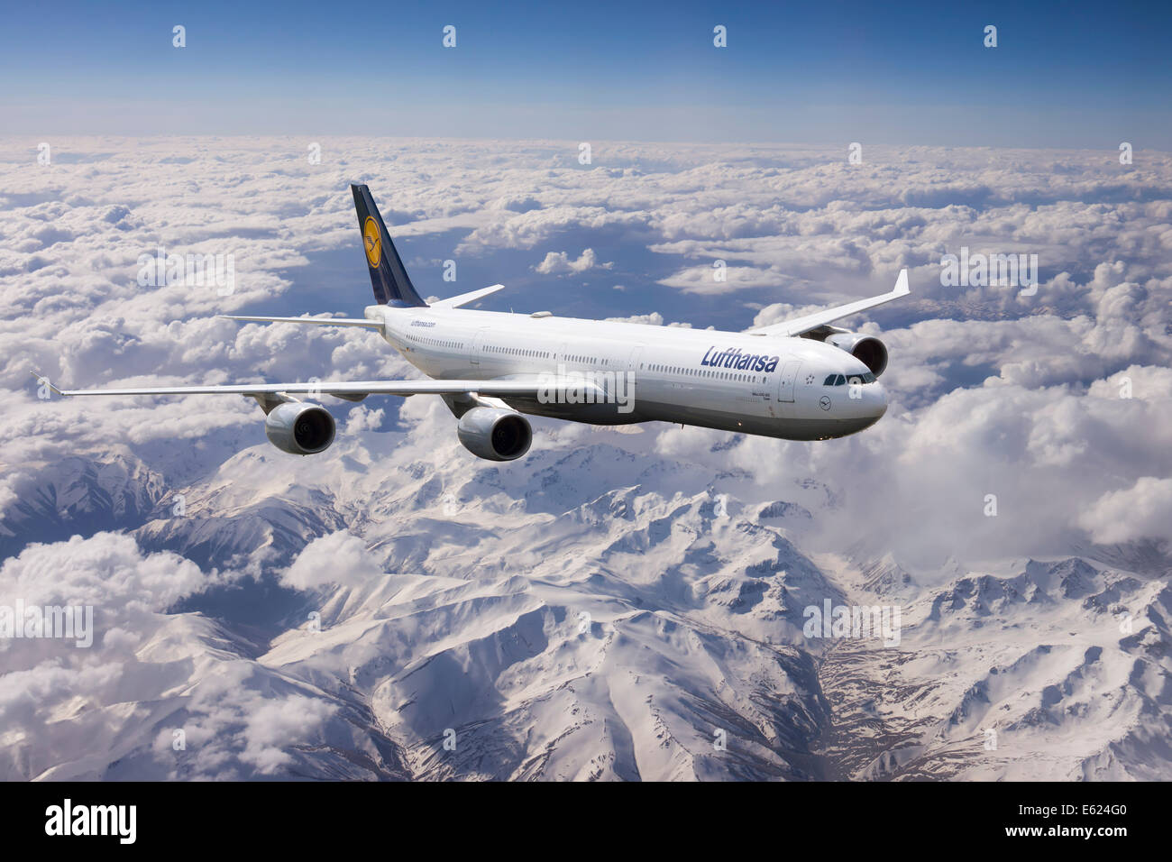 Lufthansa Airbus A340 in flight, over mountains, Turkey - Stock Image