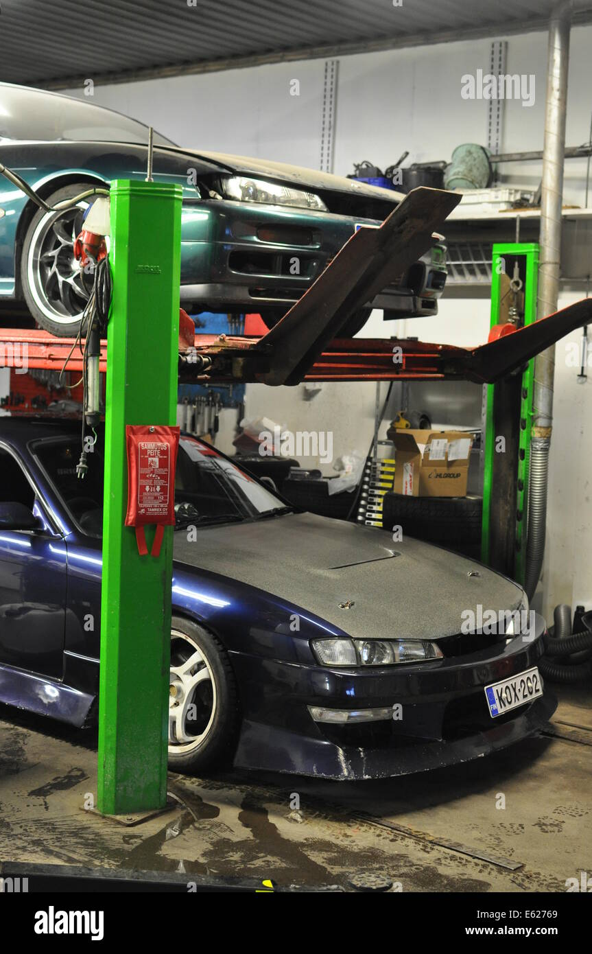 Two Nissan 200sx s14 koukis in the garage - Stock Image