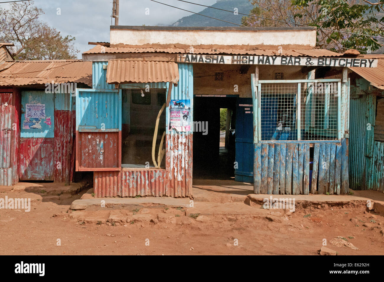 Third world corrugated iron shack or roadside shop or duka butchery on Namanga Nairobi road near Namanga Kenya East Stock Photo