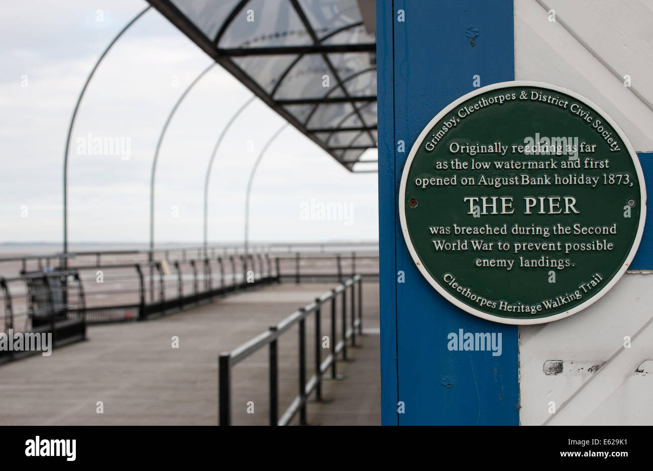 Green plaque at Cleethorpes Pier, Cleethorpes, North East Linolnshire. - Stock Image