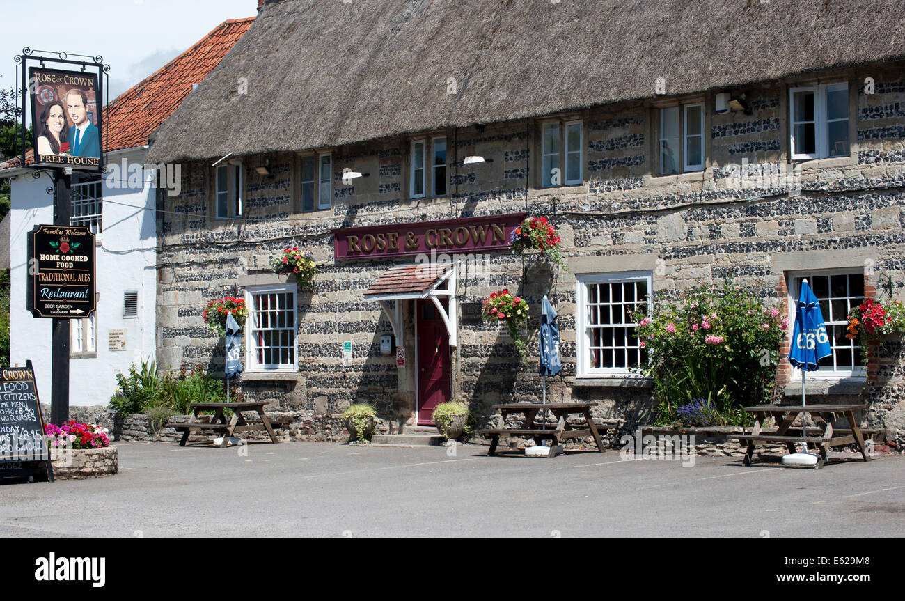 Rose and Crown , High Street, Tilshead,  Wiltshire, England, UK.; with pub sign of Prince William and Kate Middleton. - Stock Image