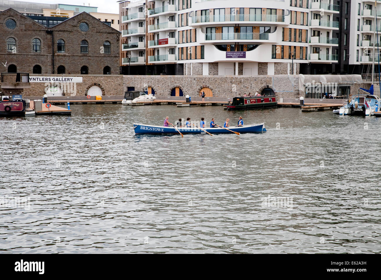 A large rowing boat on the water in Bristol UK - Stock Image