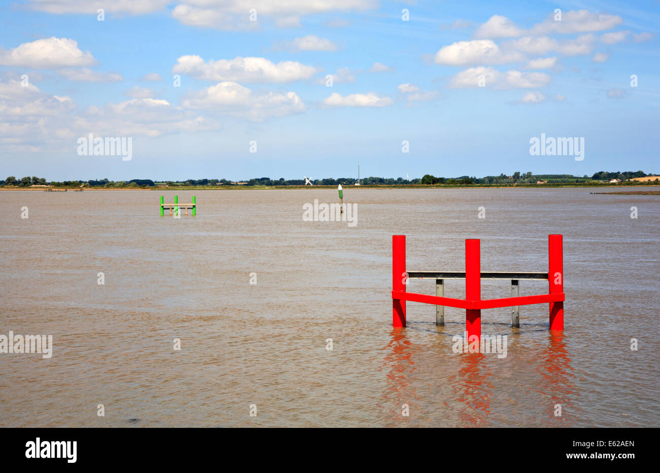 A view of Breydon Water with channel markers and mooring posts near Great Yarmouth, Norfolk, England, United Kingdom. - Stock Image