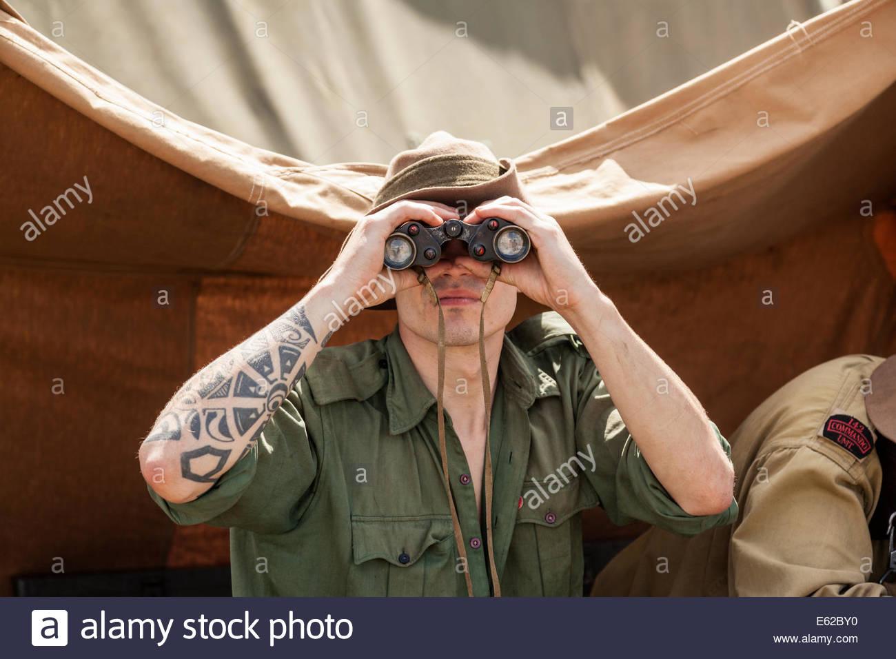 WW2 Re-enactment - Chindit Soldier looking through binoculars - Stock Image