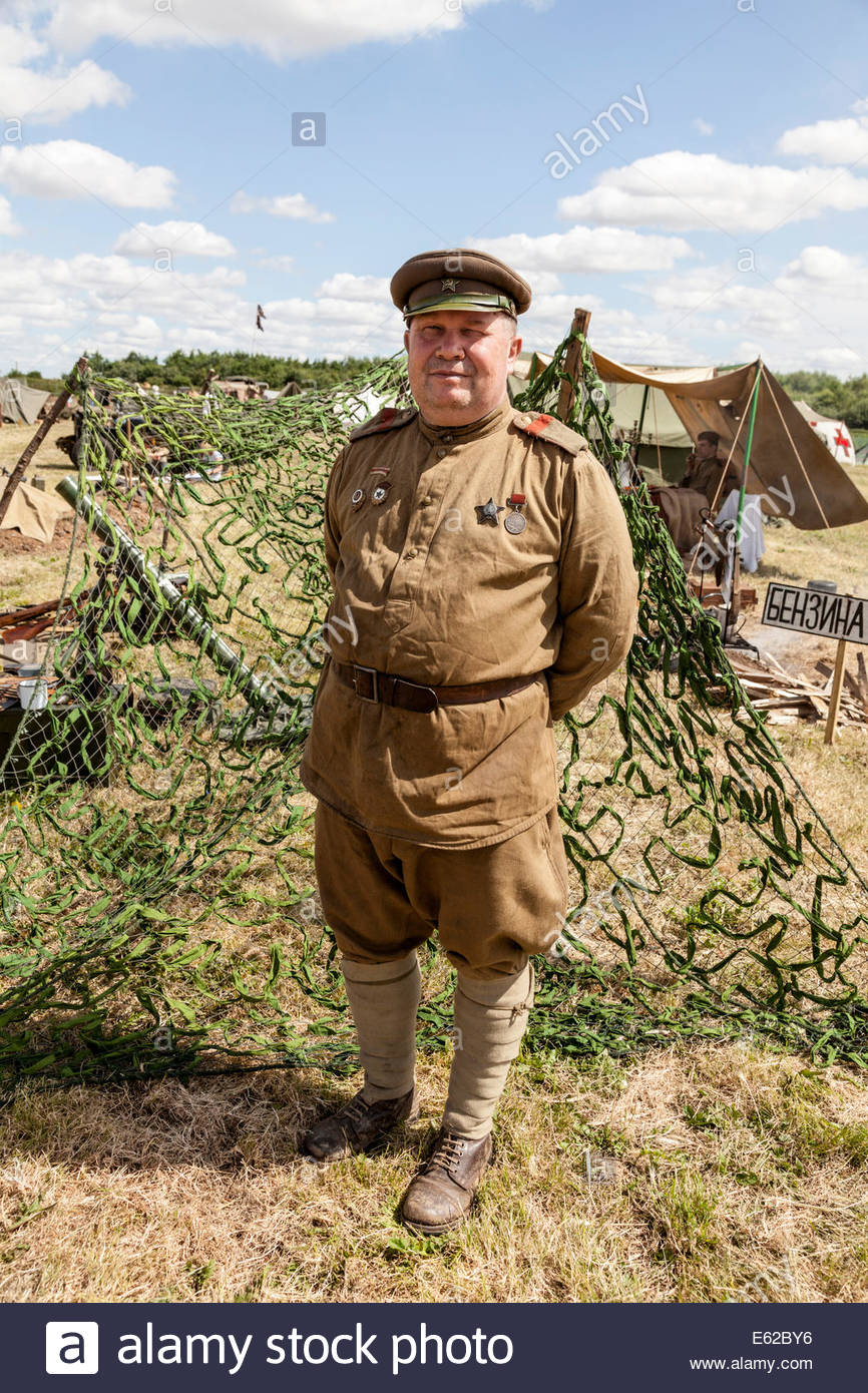 Historical Re-enactor dressed as a Russian Soldier - Stock Image