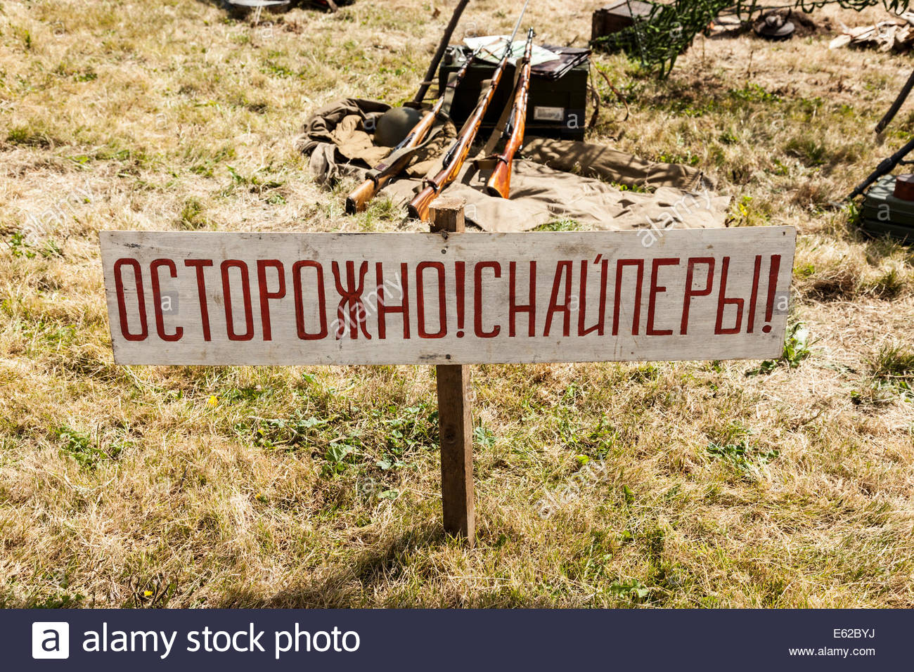 Russian Sign at a war re-enactment.  Possible translation Caution Snipers. - Stock Image